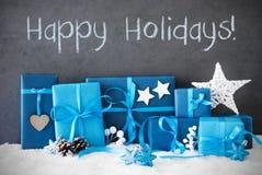 Los regalos de la Navidad, nieve, mandan un SMS buenas fiestas Fotos de archivo