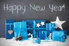 Los regalos de la Navidad, nieve, mandan un SMS a Feliz Año Nuevo Foto de archivo