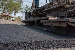 Los revestimientos flexibles consisten en el hormigón del asfalto Fotografía de archivo