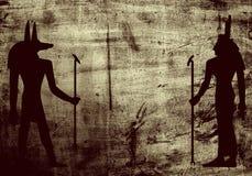 Los símbolos de la mitología de Egypti en grunge emparedan el fondo Imagen de archivo