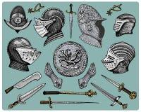 Los símbolos medievales, el casco y los guantes, el escudo con el dragón y la espada, el cuchillo y el macis, vintage del estímul Fotos de archivo