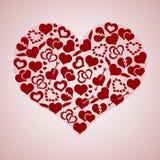 Los símbolos rojos del amor del hogar de la tarjeta del día de San Valentín en hogar grande forman Fotografía de archivo libre de regalías