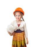 Los seis años de muchacha de la sonrisa en el casco de protección Fotos de archivo libres de regalías