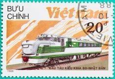 Los sellos impresos en Vietnam muestran el tren de la locomotora diesel Foto de archivo libre de regalías