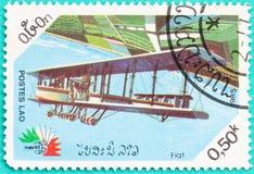 Los sellos usados con impreso en Laos muestran el avión Imagen de archivo libre de regalías