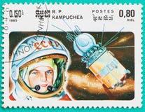 Los sellos usados imprimieron en temas del espacio de Camboya Imagenes de archivo