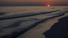 Los sistemas del sol sobre el mar fotografía de archivo libre de regalías