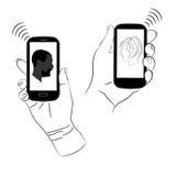 Los smartphones hacen la comunicación fácil Foto de archivo libre de regalías