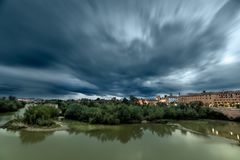 The Guadalquivir River on its way through Cordoba, Spain royalty free stock photography
