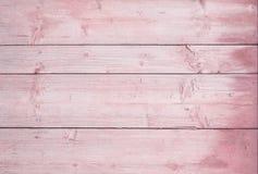 Los tableros horizontales de madera pintaron rosado Fondo de madera rosado imagenes de archivo
