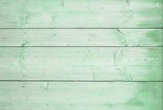 Los tableros horizontales de madera pintaron verde Fondo de madera verde fotos de archivo libres de regalías