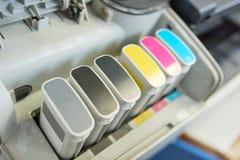 Los tanques de la tinta de impresora fotografía de archivo