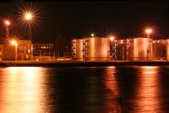 Los tanques de petróleo de la noche en el puerto #1 Fotos de archivo libres de regalías