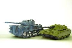 Los tanques en un fondo blanco Foto de archivo libre de regalías
