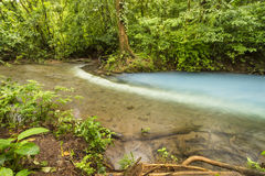 Los Teñideros. Sulphur from one stream reacts with sediment from another to form the Cerulena blue waters of the Rio Celeste in Volcan Tenorio National Stock Image