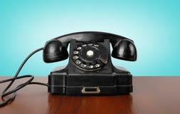 Los teléfonos del vintage - ennegrezca un teléfono retro Imágenes de archivo libres de regalías