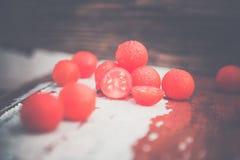 Los tomates de cereza, fotos del vintage, dispersaron los tomates Foto de archivo libre de regalías