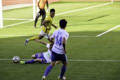 Los trastos de desplazamiento - Kaya contra sementales - fútbol de Manila unieron la liga Filipinas Imagen de archivo libre de regalías