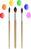 Los tres cepillos para dibujar Foto de archivo libre de regalías