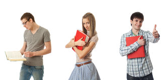 Los tres estudiantes jovenes aislados en un blanco Imágenes de archivo libres de regalías