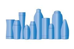 Los tubos azules en blanco de los cosméticos aislaron blanco Fotografía de archivo