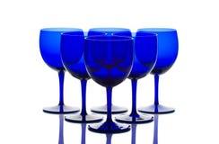 Los vidrios del azul de cobalto apoyan encendido Fotografía de archivo libre de regalías