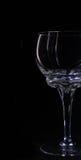 Los vidrios siluetean el vidrio de consumición en un illumin negro del fondo Fotos de archivo libres de regalías