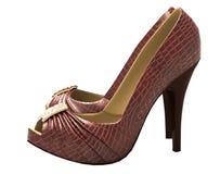 Los zapatos de las mujeres de cuero del cocodrilo con los tacones altos Fotografía de archivo