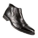 Los zapatos de los hombres clásicos en un fondo blanco Foto de archivo