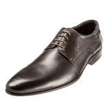 Los zapatos de los hombres clásicos en un fondo blanco Imagen de archivo