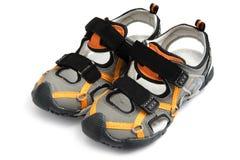 Los zapatos de los niños del verano se cierran para arriba Imagen de archivo libre de regalías
