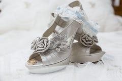 Zapatos y accesorios nupciales Foto de archivo