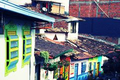 GUATAPE, ANTIOQUIA, COLOMBIA, AUGUST 08, 2018: Typically colourful buildings in Guatape. Los Zocalos - the lower parts of the facades of the houses, are usually royalty free stock images