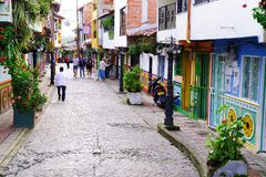 GUATAPE, ANTIOQUIA, COLOMBIA, AUGUST 08, 2018: Typically colourful buildings in Guatape. Los Zocalos - the lower parts of the facades of the houses, are usually stock photography