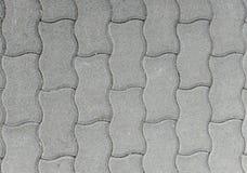 Losas o piedras grises del pavimento del hormigón o del adoquín Fotografía de archivo