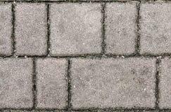 Losas o piedras grises del pavimento del hormigón o del adoquín Imagen de archivo