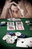 Lose player at the poker table Stock Photo