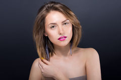 Сlose portrait of young beautiful woman with bright makeup Stock Images