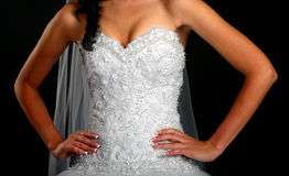 Сlose up of bride wearing wedding dress royalty free stock images