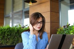Lose up face of gladden customer browsing by laptop at resta. Close up face of satisfied customer browsing and enjoying social networks at restaurant  . Happy Stock Photos