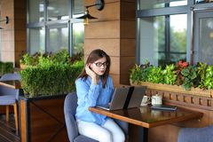 Lose up face of gladden customer browsing by laptop at resta. Close up face of satisfied customer browsing and enjoying social networks at restaurant  . Happy Royalty Free Stock Image