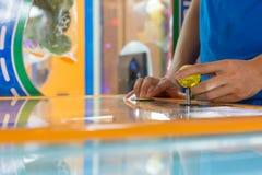 Lose up hand control joystick of arcade. Close up hand control joystick of arcade Stock Photo