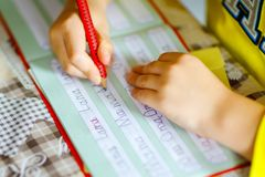 Free Lose-up Of Little Kid Boy At Home Making Homework, Child Writing First Letters And Words Like Mama With Colorful Pens Royalty Free Stock Photography - 149528987