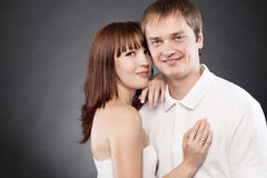 Сlose-up  portrait of beautiful loving couple posing in a studi. O Royalty Free Stock Photography