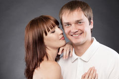 Сlose-up  portrait of beautiful loving couple. Posing in a studio Royalty Free Stock Photo