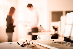 lose-up of workplace in modern office with business people behin Royalty Free Stock Photography