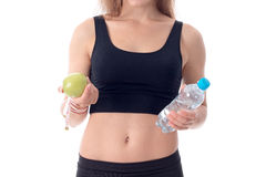 Lose-up of a young girl who shows her an apple and water Stock Images