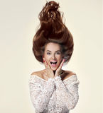 Сlose up of Young woman with trendy glamorous hairstyle Stock Images