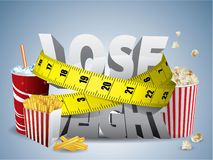 Lose weight. Text with measure tape and junk food Stock Photo