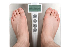 Lose weight. Concept: Lose weight. Isolation on white Stock Photos